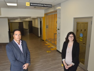 Jeffery Raymond, Manager of the Centre for Student Accessibility and Stephanie Smith, Manager of the Accommodations Test Centre outside the newly constructed Test Centre.